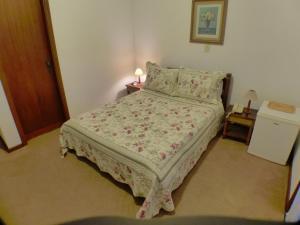 Cama ou camas em um quarto em Hotel Aldeia da Serra