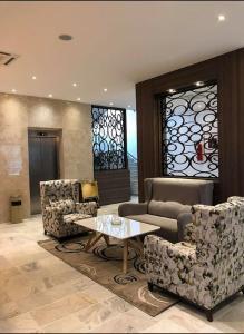A seating area at Hotel Rym El Djamil
