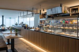 A restaurant or other place to eat at PREMIER SUITES PLUS Antwerp