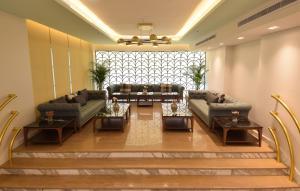 Uma área de estar em FLAMINGO Boutique Hotel