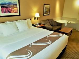 A bed or beds in a room at Quality Inn Airport Dieppe