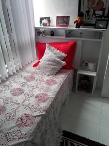 Cama ou camas em um quarto em Casa Da Lu
