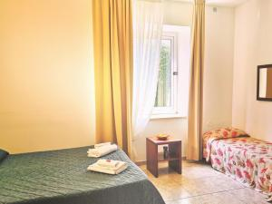 A bed or beds in a room at Hotel San Martino