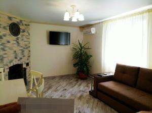 Гостиная зона в Дом для отдыха Азовская Фазенда