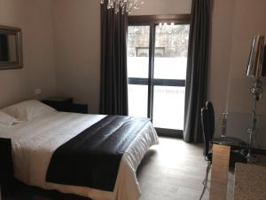 A bed or beds in a room at Alvear Suites