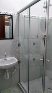 Um banheiro em Pousada Vale dos Lagos