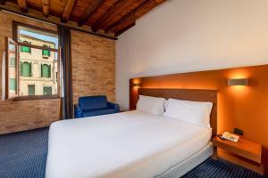 Cama ou camas em um quarto em Eurostars Residenza Cannaregio