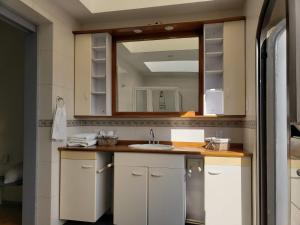 A kitchen or kitchenette at Pepper My Love!