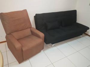 A seating area at Apartamento quarto e sala em Ponta Verde