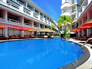 The swimming pool at or near Swissotel Hotel Phuket Patong Beach