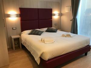 Letto o letti in una camera di Verona Apartments & Rooms