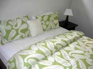 A bed or beds in a room at Portarlington Beach Motel