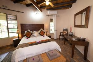 A bed or beds in a room at Blyde River Wilderness Lodge