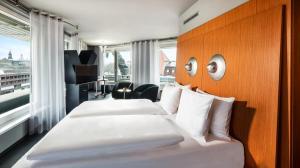 Ein Bett oder Betten in einem Zimmer der Unterkunft Penck Hotel Dresden