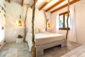 Letto o letti in una camera di Sardegna - Villa Margherita