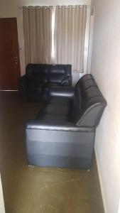 Uma área de estar em Apartamento Peruíbe