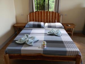 Кровать или кровати в номере The Blue Pagong