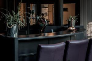 De lobby of receptie bij Hotel ten Cate Emmen