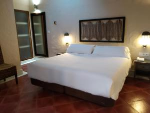 Ein Bett oder Betten in einem Zimmer der Unterkunft Beach Hotel Dos Mares