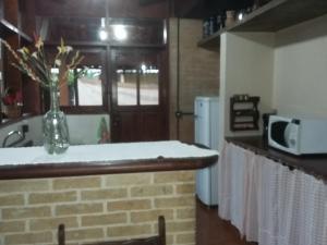 A cozinha ou cozinha compacta de CASA em UBATUBA