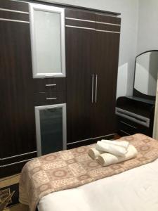 Cama ou camas em um quarto em Old City Central Apartment