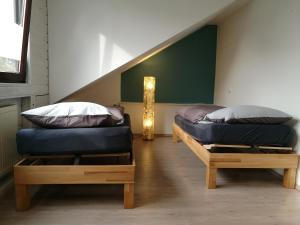 A bed or beds in a room at Helles Studio