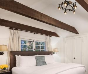 A bed or beds in a room at The Charlie West Hollywood