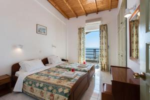 A bed or beds in a room at Nissaki Sea View