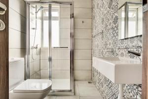 A bathroom at The Village Apartments
