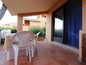 Balcone o terrazza di Villetta Residence Porto Corallo