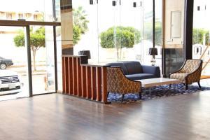 Uma área de estar em Rahwan Palace - Apartments Hotel