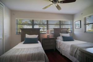 Ein Bett oder Betten in einem Zimmer der Unterkunft Majestic Palms
