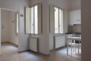 Una cocina o zona de cocina en Duomo Apartment