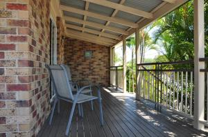 A balcony or terrace at 23 Carlo Road - Lowset family home within walking distance to the shopping centre. Pet friendly