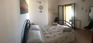 Letto o letti in una camera di B&B Villa Tancau