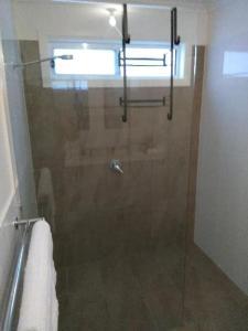 A bathroom at All seasons holiday homes