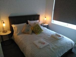 A bed or beds in a room at All seasons holiday homes