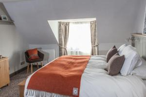 A bed or beds in a room at Bosville Hotel