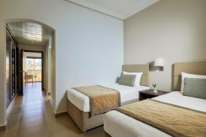 Een bed of bedden in een kamer bij Jaz Solaya