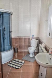 Ванная комната в Hotel Zapovednik