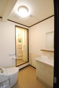 Een badkamer bij Pension Lavender