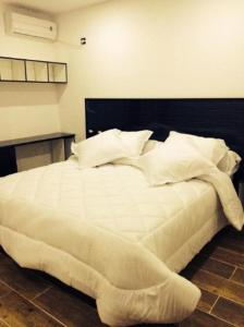 A bed or beds in a room at RAIS
