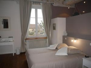 A bed or beds in a room at MAISON D'EUSEBIA