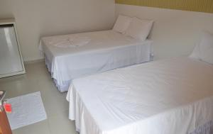 A bed or beds in a room at HOTEL FLAMBOYANT