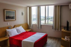 Cama ou camas em um quarto em Airam Brasília Hotel
