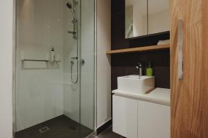 A bathroom at Mono Apartments on La Trobe Street