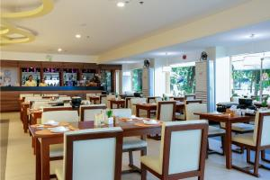 A restaurant or other place to eat at Paradise Garden Resort Hotel & Convention Center