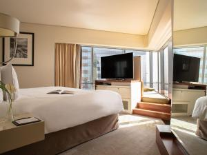 A television and/or entertainment center at Jumeirah Emirates Towers