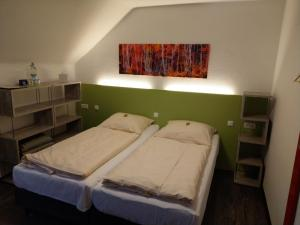 A bed or beds in a room at Pension Haus Diefenbach