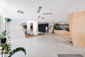 The lobby or reception area at Business Hotel Astrum Laus